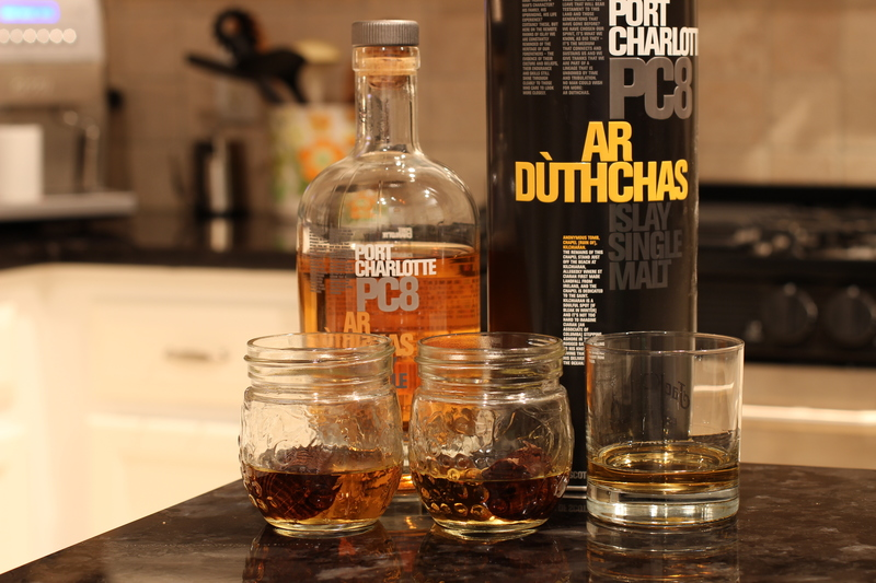 Bruichladdich Port Charlotte 8 poured into small mason jars with an oak spiral.